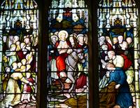 stained-glass-window-with-biblical-story-of-the-church-in-England.jpg